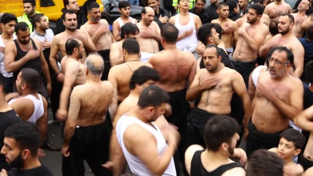 shiite muslim devotees beat their chests as they take part in a ritual selfflagellation procession on october 23 2015 in manchester england shiites... - ashura muharram stock-videos und b-roll-filmmaterial