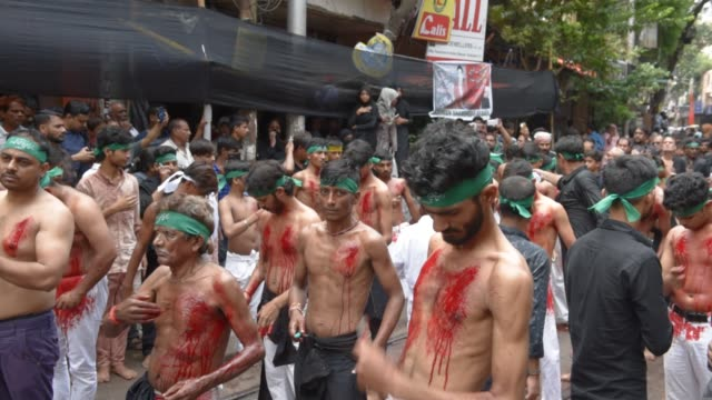 shiite muslim mourners flagellate themselves during a procession on the tenth day of muharram which marks the day of ashura in kolkata india... - ashura muharram stock-videos und b-roll-filmmaterial