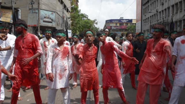shiite muslim mourners flagellate themselves during a procession on the tenth day of muharram which marks the day of ashura in kolkata india... - imam hussein stock videos and b-roll footage