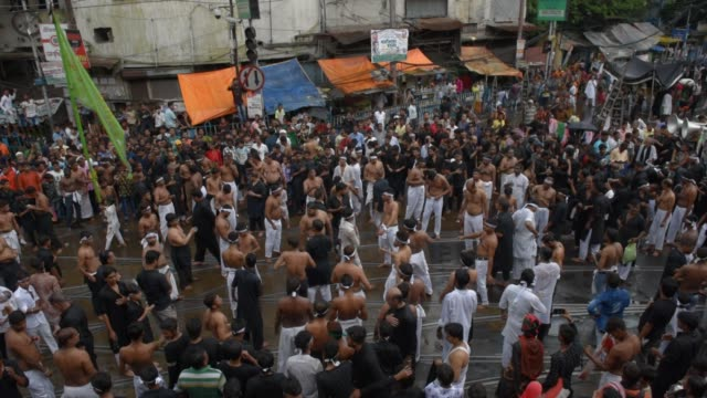 shiite muslim mourners flagellate themselves during a procession on the tenth day of muharram which marks the day of ashura in kolkata india... - remembrance day stock videos and b-roll footage
