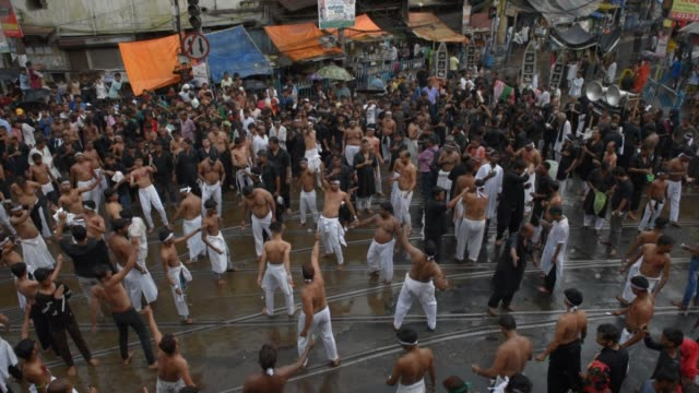 shiite muslim mourners flagellate themselves during a procession on the tenth day of muharram which marks the day of ashura in kolkata india... - ashura muharram stock videos & royalty-free footage