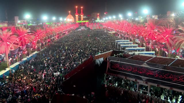 shiite muslim pilgrims celebrate the religious festival of arbaeen at the shrine of prophet mohammed's grandson imam hussein in the holy iraqi city... - shrine stock videos & royalty-free footage