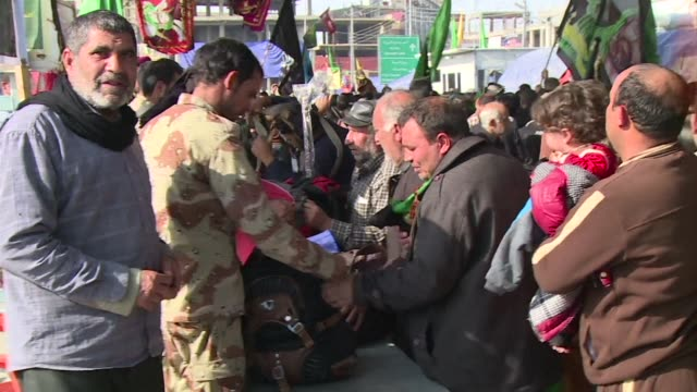 shiite muslims are flocking to the imam alhussein shrine in the central iraqi city of karbala in preparation for the the arbaeen religious festival - imam hussein stock videos and b-roll footage