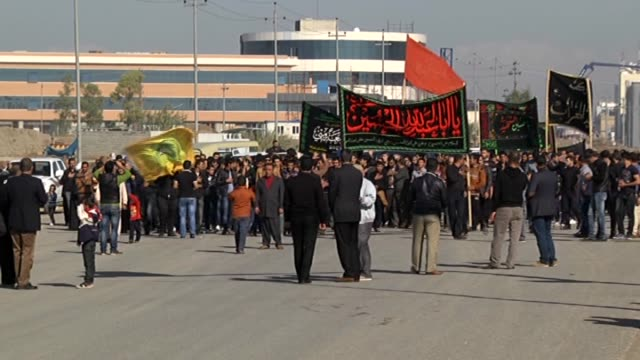 shiite muslims gather in the streets during the mourning ceremony held for the karbala martyrs in month muharram one of the four sacred months of the... - shi'ite islam stock videos & royalty-free footage