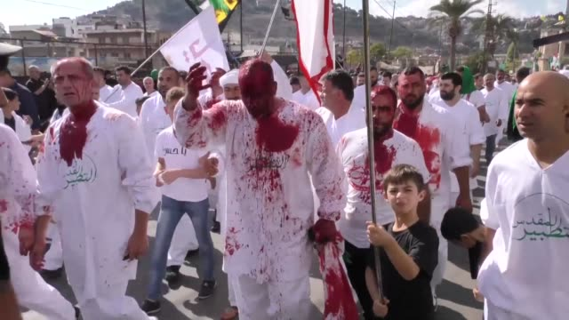 Shiite Muslims gathered in Lebanon's southern city of Nabatiyeh on Sunday for ceremonies marking the seventh century killing of the Prophet...