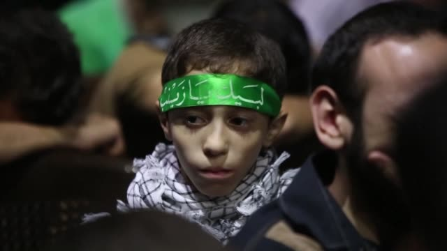 shiite muslims in the syrian capital damascus took part on monday evening in the annual ashura commemorations in the zine al abidin area that mark... - imam hussein stock videos and b-roll footage