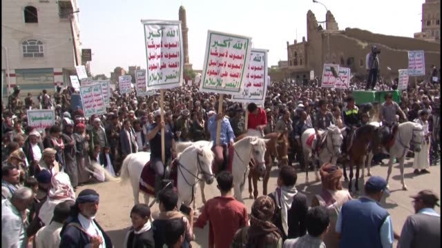shiite muslims supporting yemen's huthi rebels chant slogans during a rally commemorating the tenth day of the month of muharram which marks the peak... - ashura muharram stock videos & royalty-free footage
