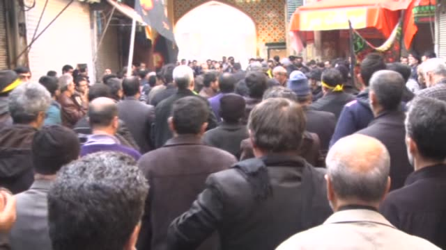 shi'ite people gather at imam hussein square during the arba'een ceremony in tehran iran on 13 december 2014 hundreds of shiite worshippers attend... - imam hussein stock videos and b-roll footage