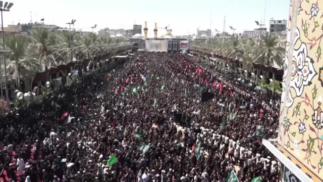 shiite pilgrims flock to the holy shrine city of karbala to perform ashura rituals commemorating the death of hussein prophet mohammad's grandson... - muharram stock videos & royalty-free footage