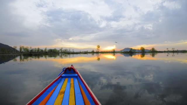 ms pov shikara moving on dal lake at dusk / srinagar, jammu and kashmir, india   - jammu e kashmir video stock e b–roll