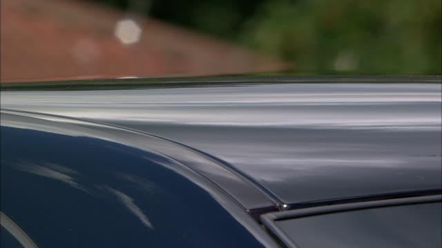 Shimmering air rises from car in heat haze, Bristol, UK