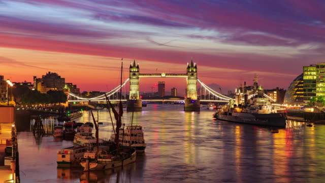 A shimmering night view of Tower Bridge transforms as the sun rises over London.
