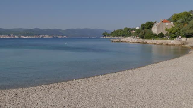 vídeos y material grabado en eventos de stock de shingle beach, orebic, dalmatia, croatia, europe - cultura croata