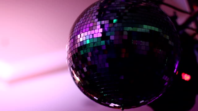 shining disco ball in motion - mirror object stock videos & royalty-free footage