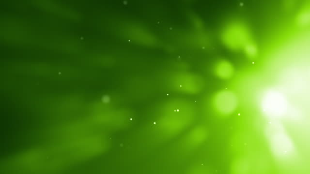 shining particles loop - side glow green (full hd) - green background stock videos & royalty-free footage