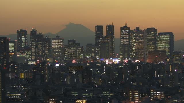 WS, HA, Shinjuku District illuminated at dusk with Mt Fuji in background, Tokyo, Japan