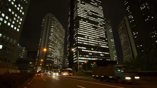 shinjuku skyscrapers at night - moving past video stock e b–roll