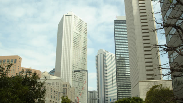 shinjuku office towers - tilt up stock videos & royalty-free footage