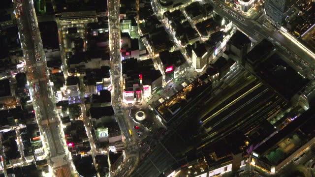 aerial, shinjuku station at night, tokyo, japan - shinjuku ward stock videos & royalty-free footage