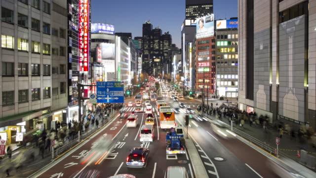 MS, TL Shinjuku traffic at dusk / Tokyo, Japan