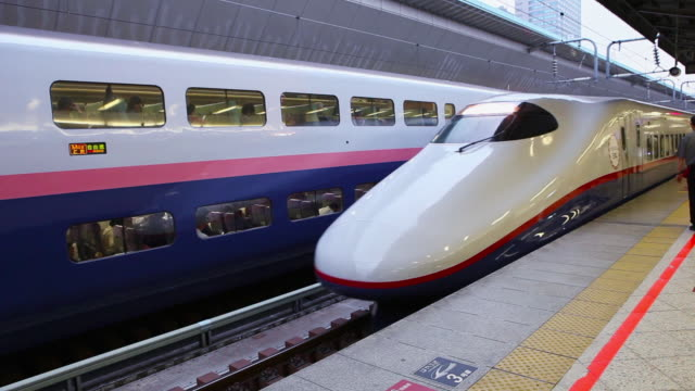 Shinkansen arriving at station in Tokyo, Japan