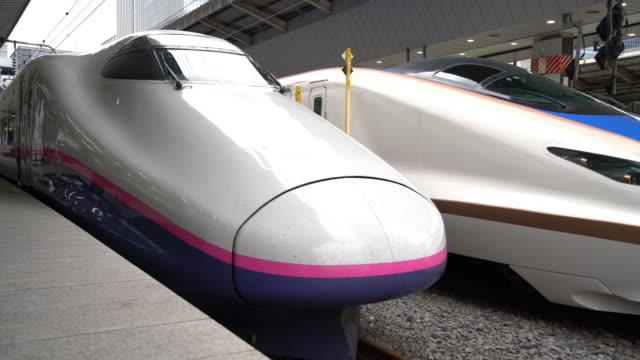 ms shinkansen bullet train arriving at tokyo station / tokyo, japan - shinkansen stock videos & royalty-free footage