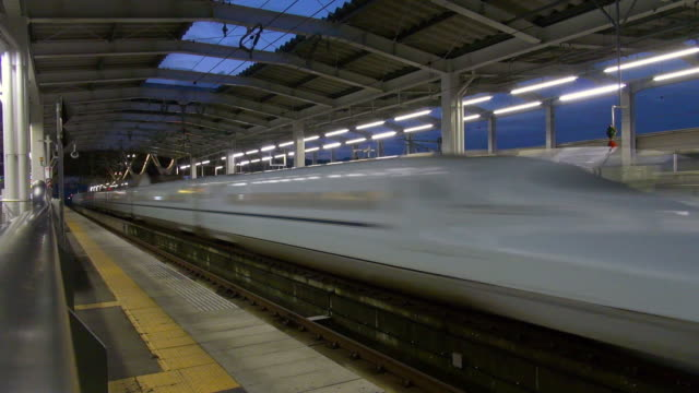 Shinkansen passing through station
