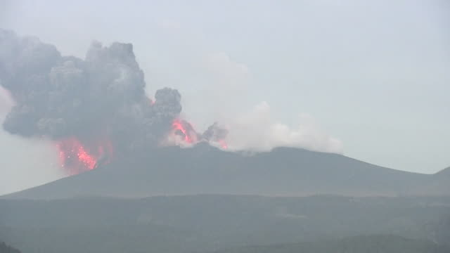 shinmoedake volcano violently spouts lava and erupts ash column / mount shinmoedake in southern kyushu of japan erupted on january 19 and repeated... - pyroklastischer strom stock-videos und b-roll-filmmaterial
