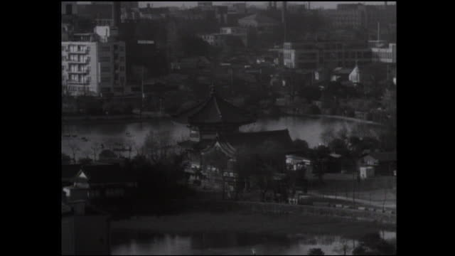 shinobazu pond surrounds bentendo temple in ueno park. - shinobazu pond stock videos and b-roll footage