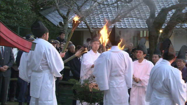shinto monks perform a ceremony with torches. - shinto stock videos and b-roll footage