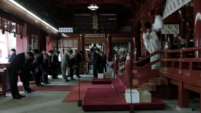 shinto priest blessing visitors on the first business day of the year at the kanda myojin shrine in tokyo, japan on monday, january 4, 2021. - shinto shrine stock videos & royalty-free footage