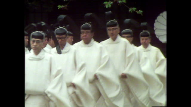 shinto priests walk together in a line at shrine; 1981 - shinto shrine stock videos & royalty-free footage