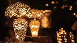 shiny background of illuminated beautiful lighting lamps, closeup view