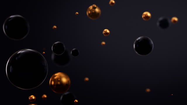 shiny black and gold three dimensional spheres floating - black background stock videos & royalty-free footage