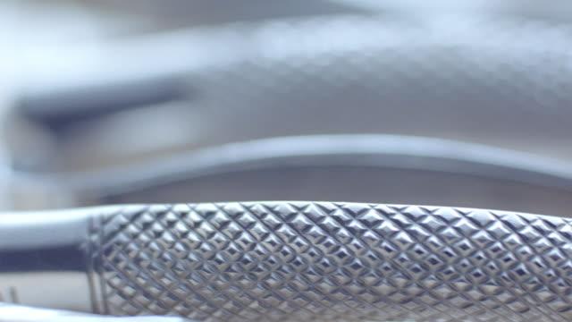 vídeos de stock, filmes e b-roll de shiny chrome dental instruments fill a tray in a dental office. - cromo metal