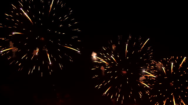 shiny gold firework display - firework explosive material stock videos & royalty-free footage