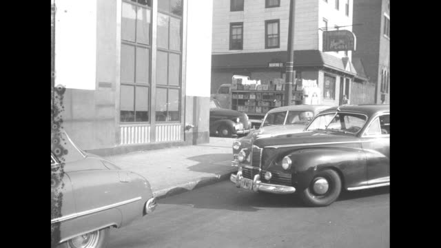 shiny large 1942 packard sedan drives diagonally into small parking space and stops / note film has nitrate deterioration - parallel parking stock videos & royalty-free footage