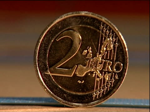 shiny new 2 euro coin - european union coin stock videos & royalty-free footage