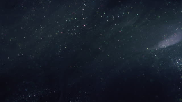 shiny particle background 4k uhd - particle stock videos & royalty-free footage