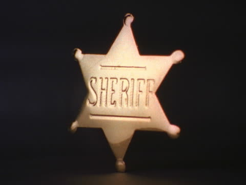 shiny sheriff badge turning - badge stock videos & royalty-free footage