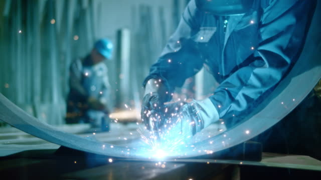 slo mo ld shiny sparks and gases forming at welding - welder stock videos & royalty-free footage