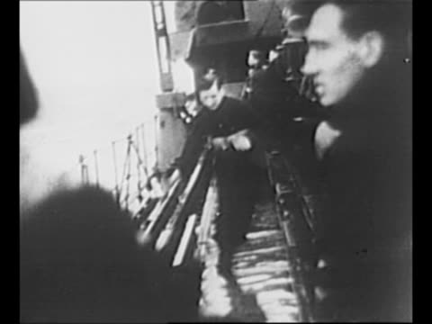 ws ship approaches in rough waters of north sea during world war ii / british sailor approaches as he runs on pitched wet deck of ship / camera ship... - 1940 bildbanksvideor och videomaterial från bakom kulisserna