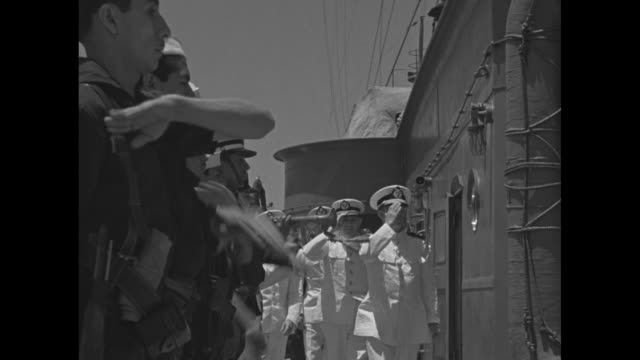 ship at dock in tampico harbor / rear view of italian freighter at dock in harbor / two mexican naval officers on board ship salute and shake hands /... - nazi flag stock videos & royalty-free footage
