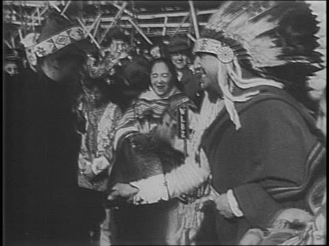 ship at dock surrounded by crowds / crowd gathered under banner welcoming eleanor roosevelt / pan from ship to penobscot tribe members dancing /... - headband stock videos and b-roll footage