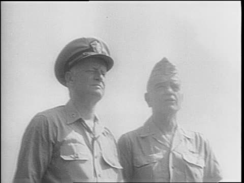 us ship at sea fires weapons / artillery fire hits japanese plane sending it to the water bursting in flames / us sailors stand at attention on a... - william halsey stock-videos und b-roll-filmmaterial