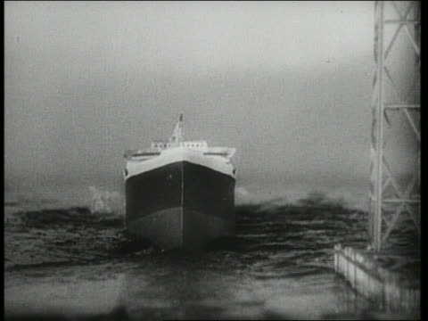 b/w 1942 ship being launched sinks into ocean / we do it because... - sink stock videos & royalty-free footage