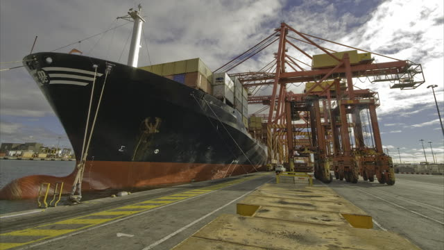 Ship being loaded by straddle cranes, Melbourne docks