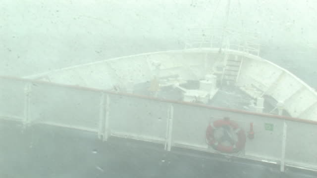 cu, ship bow moving through stormy seas and swells, waves crashing over bow, view through window, south georgia island, falkland islands, british overseas territory - ship stock videos & royalty-free footage