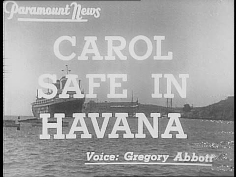 Ship called 'America of the United States Lines' docks in Havana / Madame Lupescu disembarks boat with her three dogs / Madame Lupescu and King Carol...