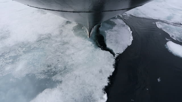 Ship carving through ice